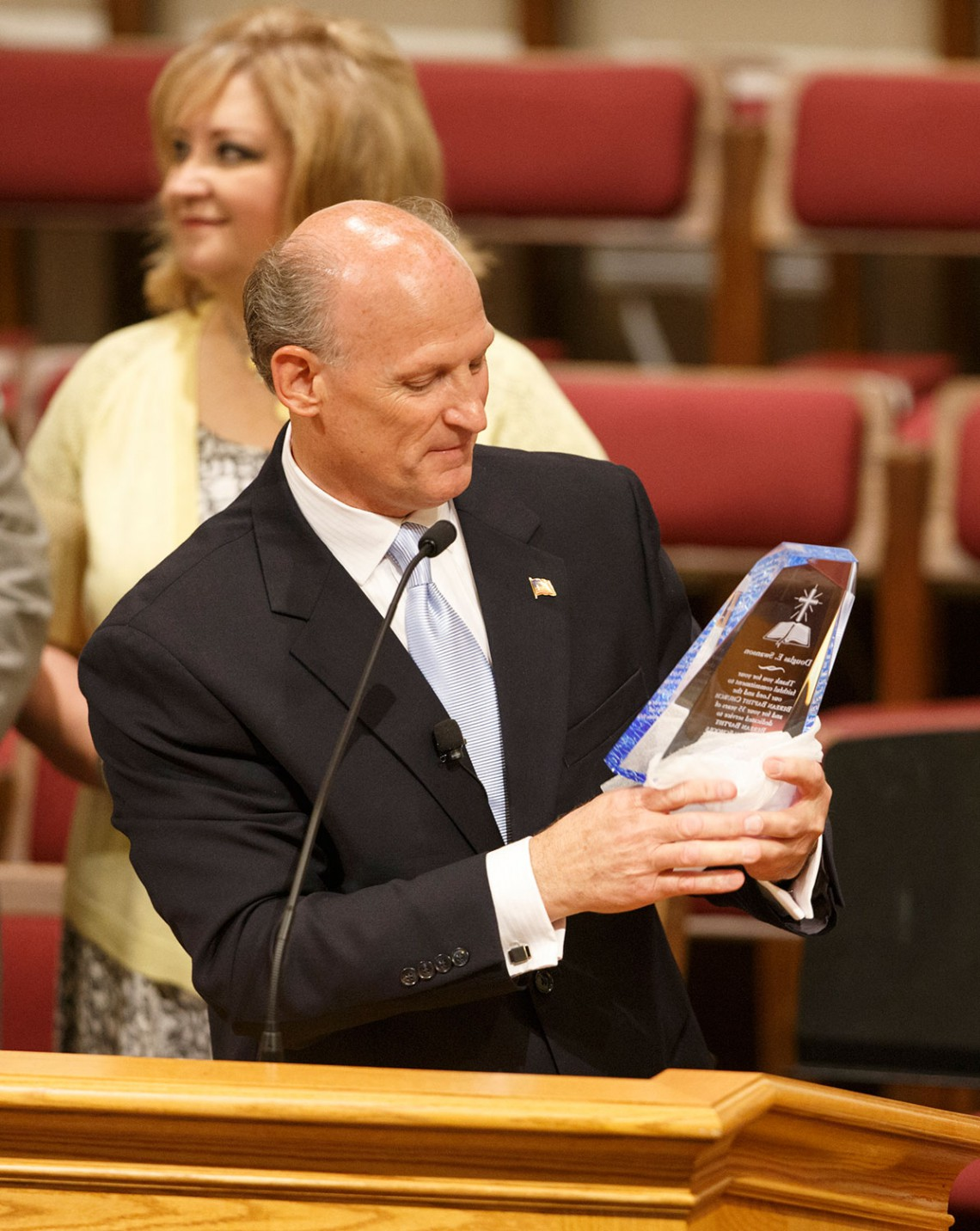 Pastor Presents Award